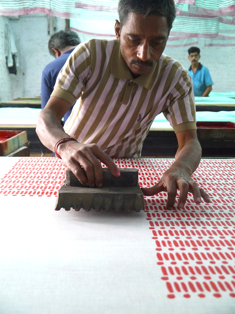 Traditional block printing with a beautiful pattern emerging.